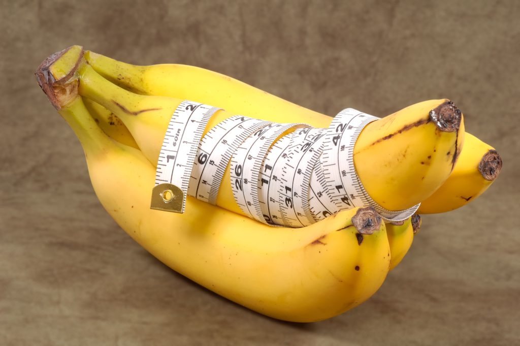 Bananas With a Tape Measure Wrapped Around It. Diet Concept - Clipping Path Included